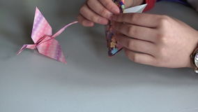 Japanese woman hands folding Japanese paper origami stock video