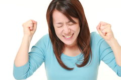Japanese woman with happy gesture Royalty Free Stock Photo