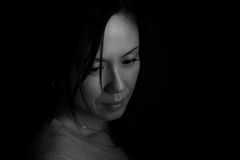 Japanese Woman Headshot. A black and white headshot of a sad looking middle aged Japanese woman stock images