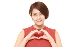 Japanese woman with heart Royalty Free Stock Images