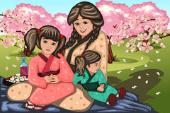 Japanese woman and her children during Cherry Blossom Royalty Free Stock Images