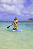 Japanese woman on her paddle board Stock Photography