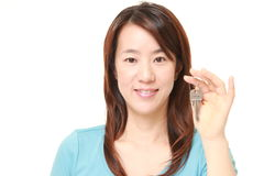 Japanese woman with home key Royalty Free Stock Image