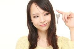 Japanese woman with home key royalty free stock photography