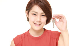 Japanese woman with home key stock photography