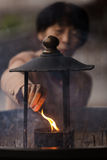 Japanese woman igniting incense Royalty Free Stock Photos