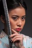 Japanese woman with katana royalty free stock photography