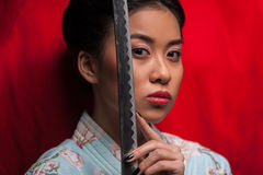 Japanese woman with katana Stock Photo