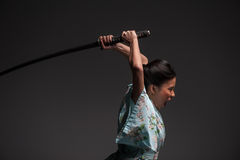 Japanese woman with katana Stock Photography