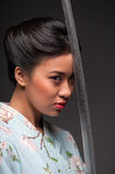 Japanese woman with katana Stock Images