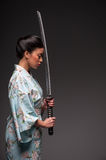 Japanese woman with katana Royalty Free Stock Images