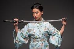 Japanese woman with katana Stock Image