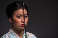 Japanese woman with katana Royalty Free Stock Image