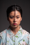 Japanese woman with katana Royalty Free Stock Photography