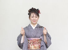 Japanese woman in a kimono Royalty Free Stock Image