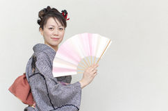 Japanese woman in a kimono Royalty Free Stock Images