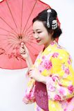 Japanese woman with kimono Japanese bride smiling white background. Japanese bride wearing a yellow kimono and carrying a red umbrella poses outdoors under a Stock Photography