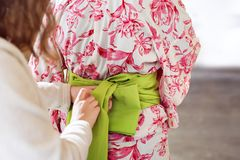 Japanese woman in kimono. No face, back view. Asian traditional clothes. Royalty Free Stock Photos