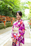 Japanese woman with Kimono in temple Stock Photography