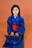 Japanese woman with laptop Stock Photo