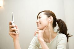 Japanese woman listening to the music Royalty Free Stock Photo