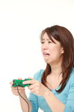 Japanese woman losing playing video game Stock Photography