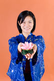 Japanese woman with lotus Royalty Free Stock Image