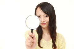 Japanese woman with a magnifying glass Stock Photos