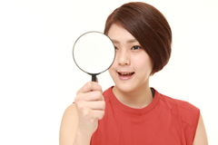Japanese woman with a magnifying glass Stock Photo