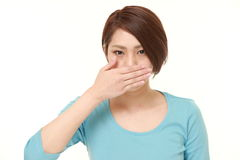 Japanese woman making the speak no evil gesture Stock Image