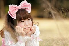 Japanese woman in meadow Stock Photo
