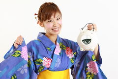 Japanese woman with mosquito coil Stock Photography