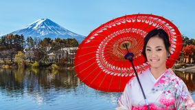 Japanese Woman with Mt. Fuji at Lake Kawaguchiko Royalty Free Stock Photography