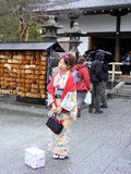 Japanese woman in national dress. KYOTO, JAPAN - APRIL 16, 2010: Cute Japanese girl in a national kimono Stock Photo