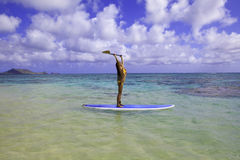 Japanese woman on a paddle board Stock Photography