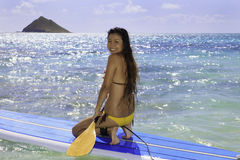 Japanese woman on a paddle board Stock Images