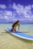 Japanese woman on a paddle board Stock Photo