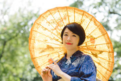 Japanese woman with parasol Royalty Free Stock Photo