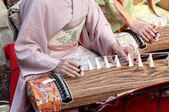Japanese woman playing the traditional instrument Royalty Free Stock Photo