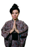 Japanese woman praying Royalty Free Stock Photography
