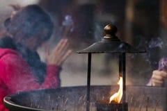 Japanese woman praying Stock Images