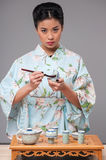 Japanese woman preparing tea ceremony Stock Photography