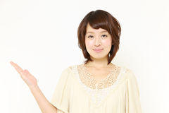 Japanese woman presenting and showing something. Concept shot of Japanese woman's lifestyle stock photography