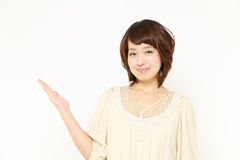 Japanese woman presenting and showing something. Concept shot of Japanese woman's lifestyle stock photo
