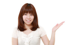 Japanese woman presenting and showing something Stock Images