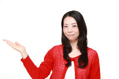 Japanese woman presenting and showing something Stock Image