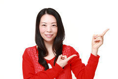 Japanese woman presenting and showing something Royalty Free Stock Photo