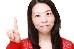 Japanese woman presenting and showing something Stock Photo