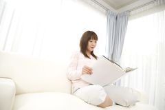 Japanese woman reading a book Royalty Free Stock Image