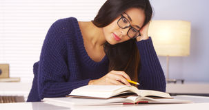 Japanese woman reading books and taking notes Royalty Free Stock Photos